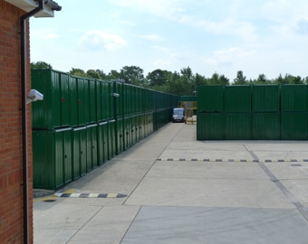 Ranks of green storage containers at the Eversley site