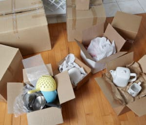 Cardboard boxes full of kitchenware - storage top tips